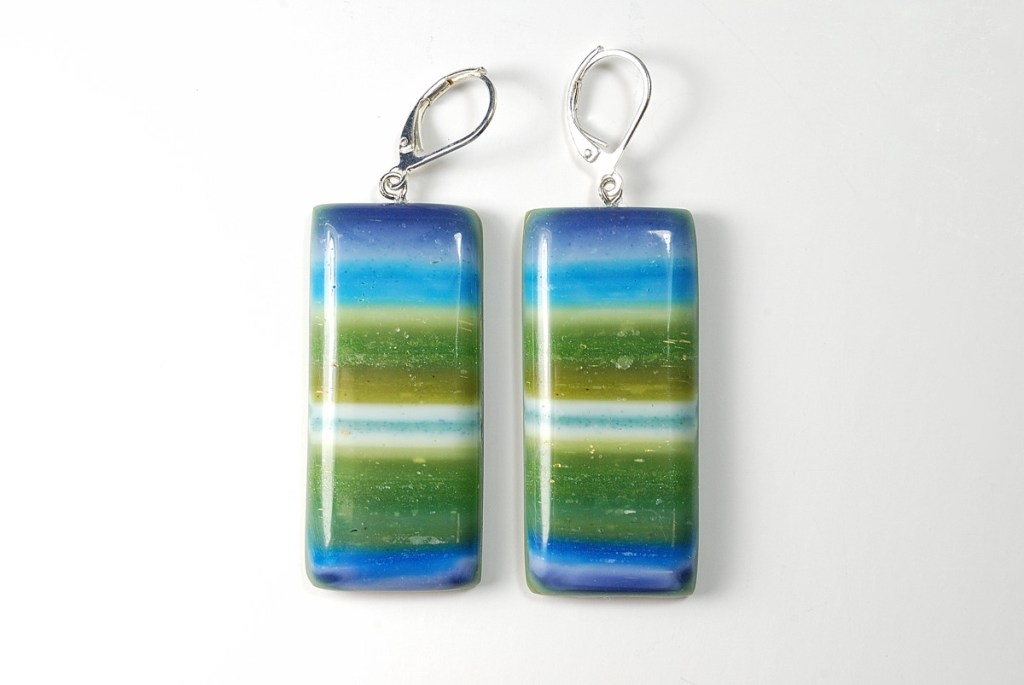 Striped polymer clay earrings in colors of blue and green created with Lynda Moseley's Controlled Marbling Tutorial.