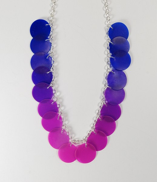Graduated colors of cobalt blue to fuchsia transition in this wafer necklace made from polymer clay.
