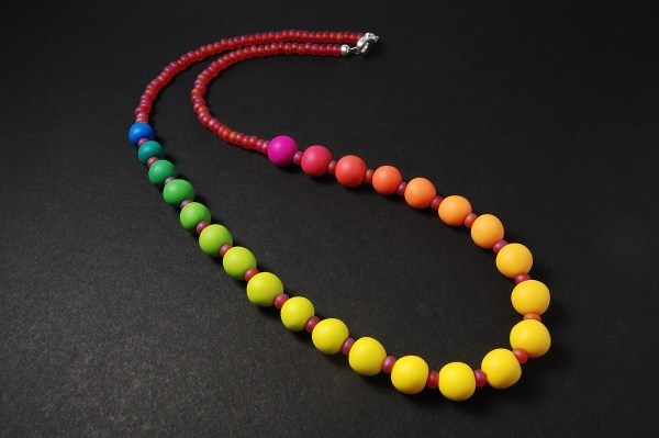 Rainbow gradient beaded necklace made from Kato polymer clay.