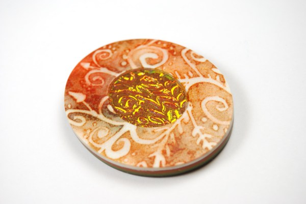 Orange batik amulet made with the Holo Effect Tutorial by The Blue Bottle Tree.