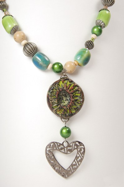 Detail view of Do Over Challenge necklace showing the rustic polymer clay focal bead.