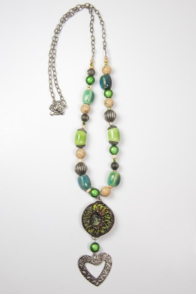Finished Do Over Challenge necklace featuring ceramic beads and a handmade rustic focal bead made from polymer clay.