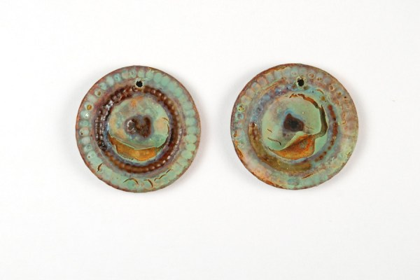 A coating of liquitex matte varnish caused the patina areas to crackle on these polymer clay beads that have been treated with VerDay Paint and Patina. By The Blue Bottle Tree.