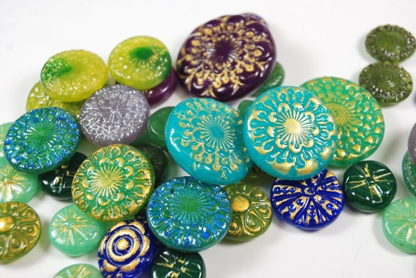 A collection of Faux Czech Glass Beads made from polymer clay by The Blue Bottle Tree.