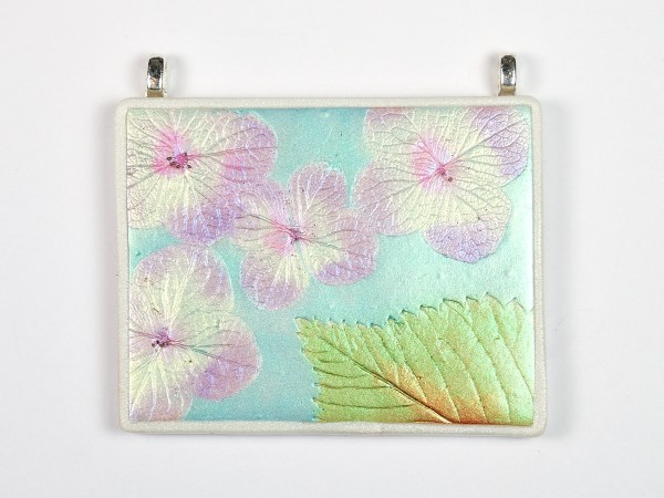 You can use light colors and flowers to create a pendant with the Mica Leaf Tutorial from The Blue Bottle Tree.