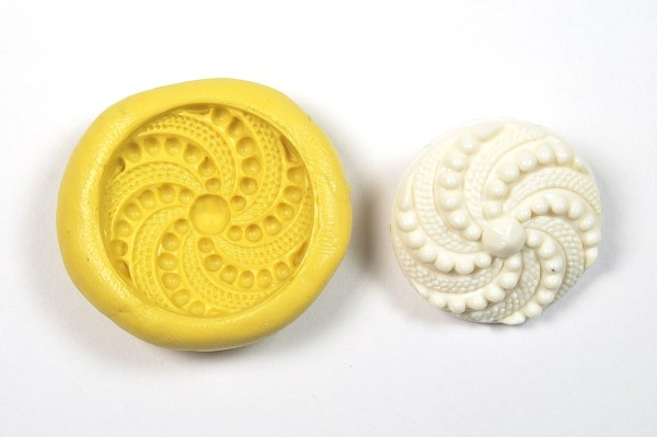 Making molds with silicone rubber mold putty. Learn about the silicone rubber mold material in this article.