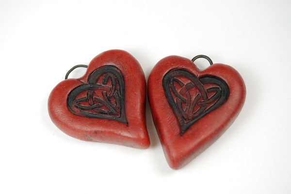 Red rustic polymer clay heart pendants, perfect for Valentine's Day.