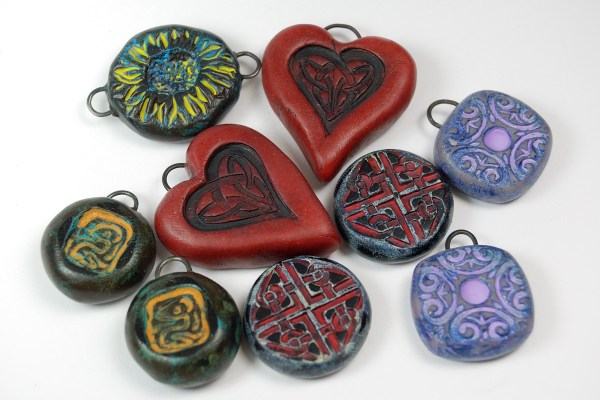 Rustic pendants and beads made from polymer clay by Ginger Davis Allman.