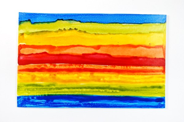 Alcohol Inks stay separated better when sealed between colors with PYM II.
