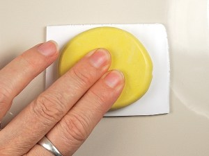 Turn the mold over and place the sheet onto a ceramic tile.