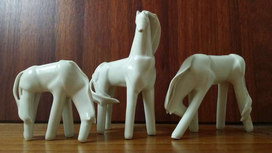Porcelain hollow form horses and Giraffe. I like to think of these as the ancestors to my current Polymer clay horses!