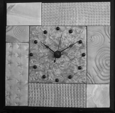 Silver mica shift mosaic clock made from polymer clay.
