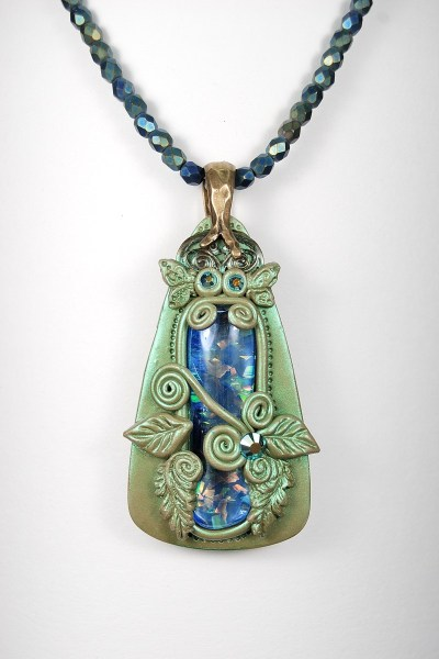 Chris Crossland inspired me to make this pendant with polymer clay and a glass gem.