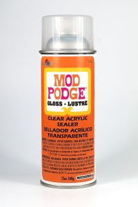 Mod Podge Acrylic Spray Sealer is not compatible with polymer clay and will remain sticky.