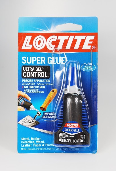 Loctite Ultra Control Gel is perfect for glueing crystals in place on baked polymer clay.