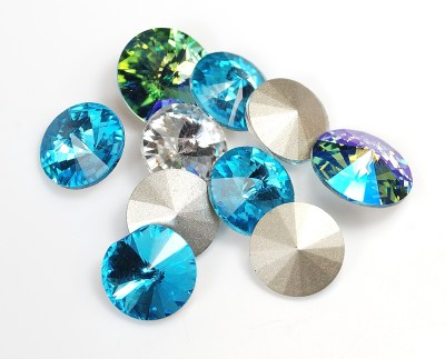 Rivioli crystals are large point-backed glass crystals. They can be embedded into polymer clay and then baked.