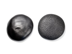 Fingerprints and fine bubbles can be disguised by texturing the surface of polymer clay.