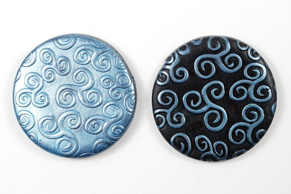 You can use mica powder to highlight the textures create in polymer clay with the Kor rollers.