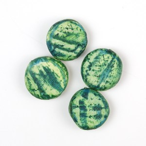 You can use alcohol inks to color and stain baked polymer clay to give unique and interesting effects.