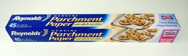 Parchment paper is often recommended for use with polymer clay. It doesn't, however, offer much advantage over plain copy paper.