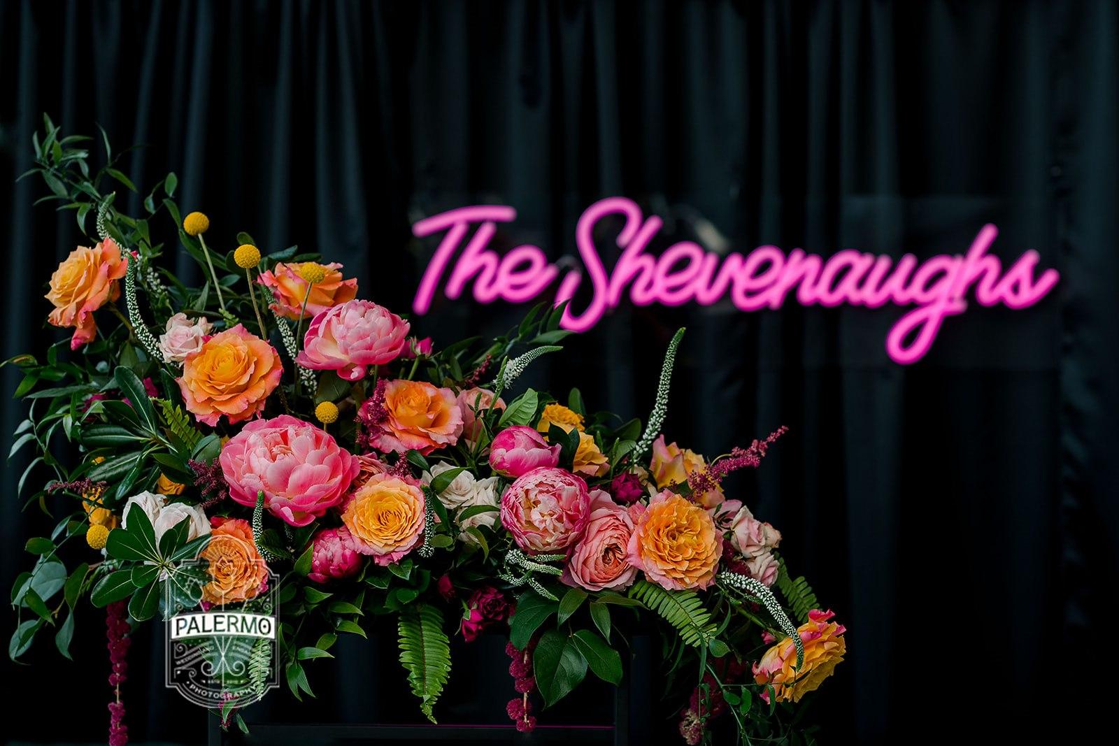 bridal couple neon sign wedding flowers ceremony arrangement