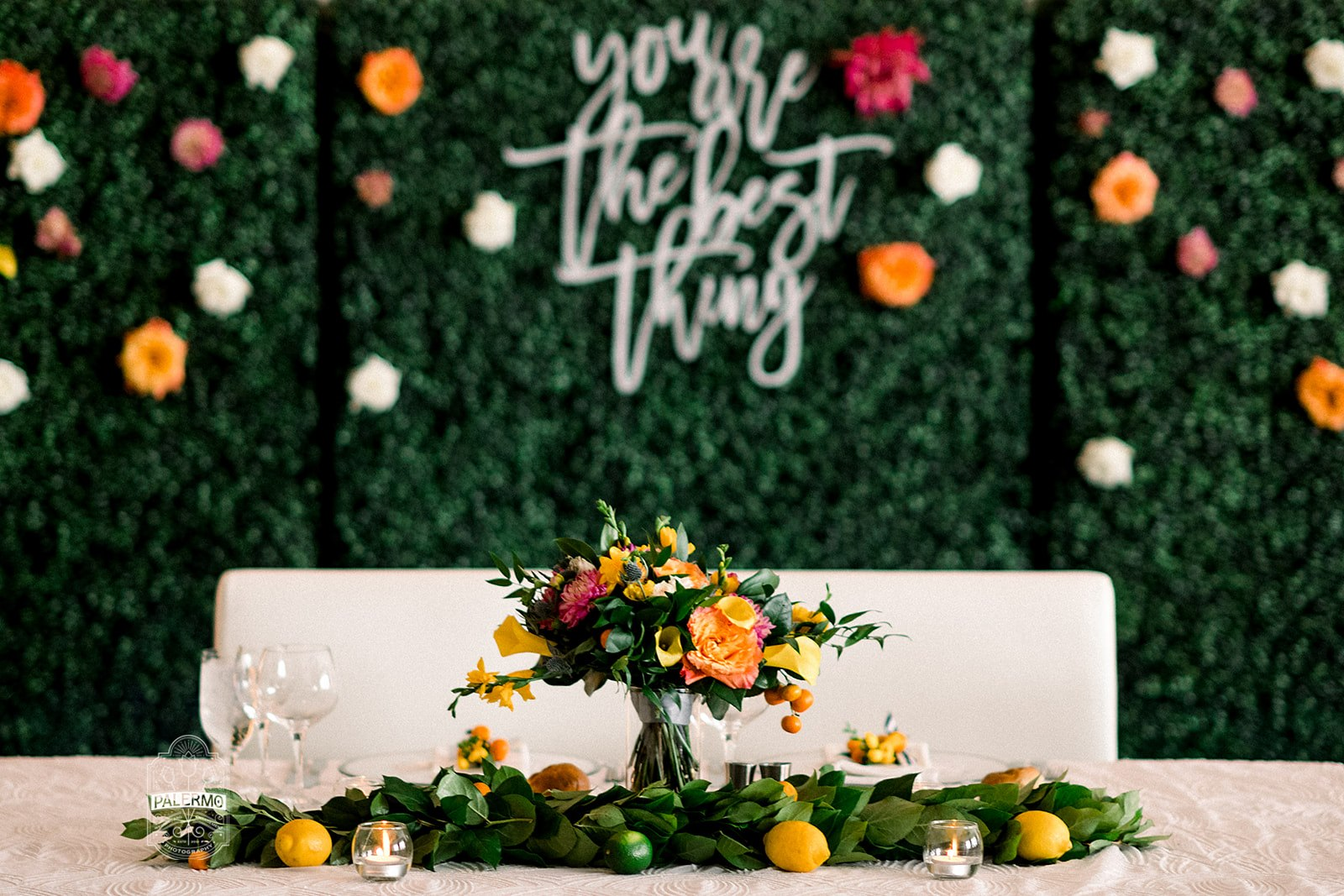 wedding head table boxwood hedges backdrop greenery garland citrus bridal bouquet summer wedding garden party