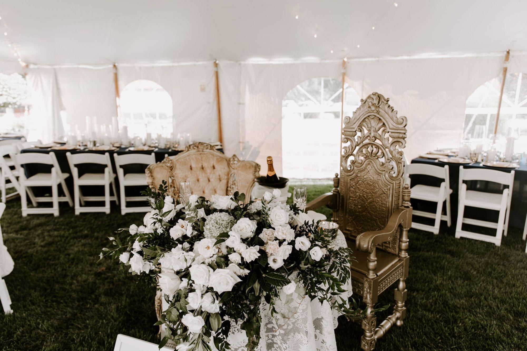 vintage sweetheart table design outdoor tented backyard wedding