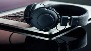 Brett Smeltzer, headphones and laptop