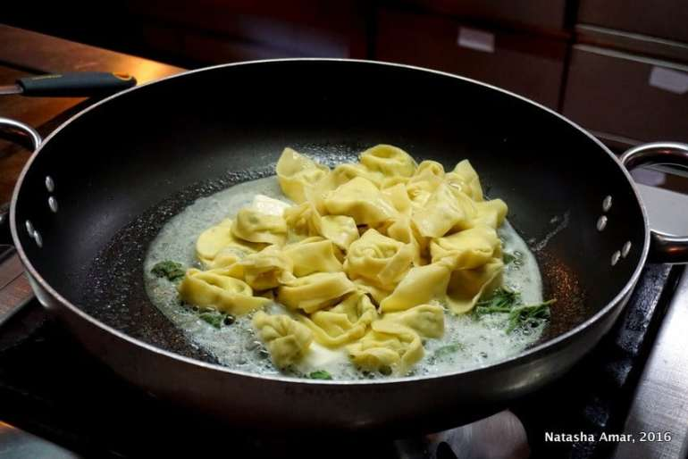Tortelloni Pasta in bologna, Italy: Love Italian food? Take a cooking class in Italy where you'll learn to prepare classic pasta dishes and taste as well. This is a bucketlist worthy experience for foodies traveling to Italy. #Italytravel #Italycookingclass