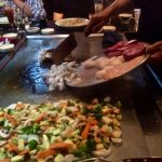 Fresh seafood and meat being added to yep-an grill