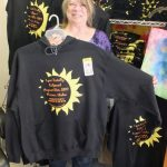 Renee with Solar Eclipse t-shirts and sweatshirts at Happy Thoughts For You