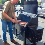 Checking ribs on Sawtooth Grill's smoker