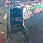 David from Owyhee BBQ tasting chicken