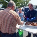 Getting a BBQ sample from Swine Stewards BBQ Team