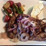 Ribeye Steak special with grilled onions