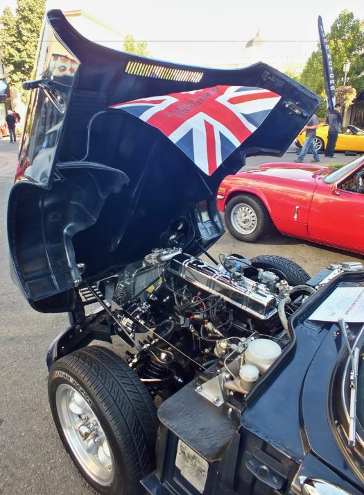 The wind blowing the British flag on car