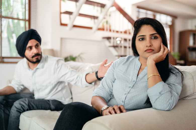 young indian couple having quarrel at home