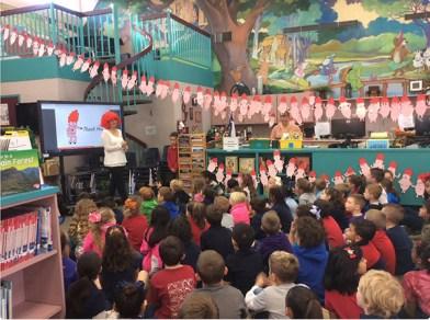 Emma J. Virjan speaks to a school in Austin.