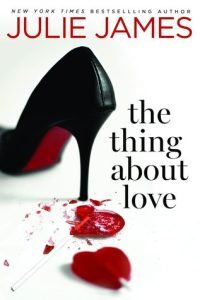 a black high-heeled shoe with a red candy heart shattered under the heel