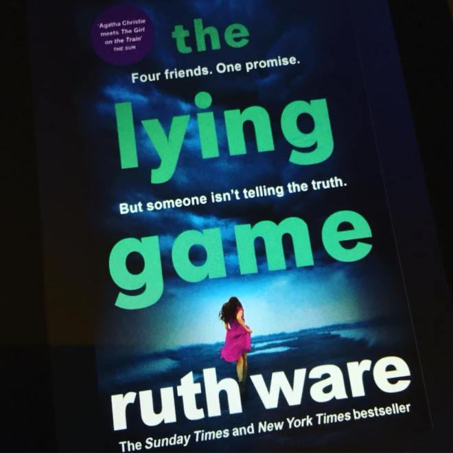 Image may contain: one or more people, text that says 'the Four friends. One promise. ly lying game someone isn't telling the truth. But ruth ware bestseller The Sunday Times and New York Times'