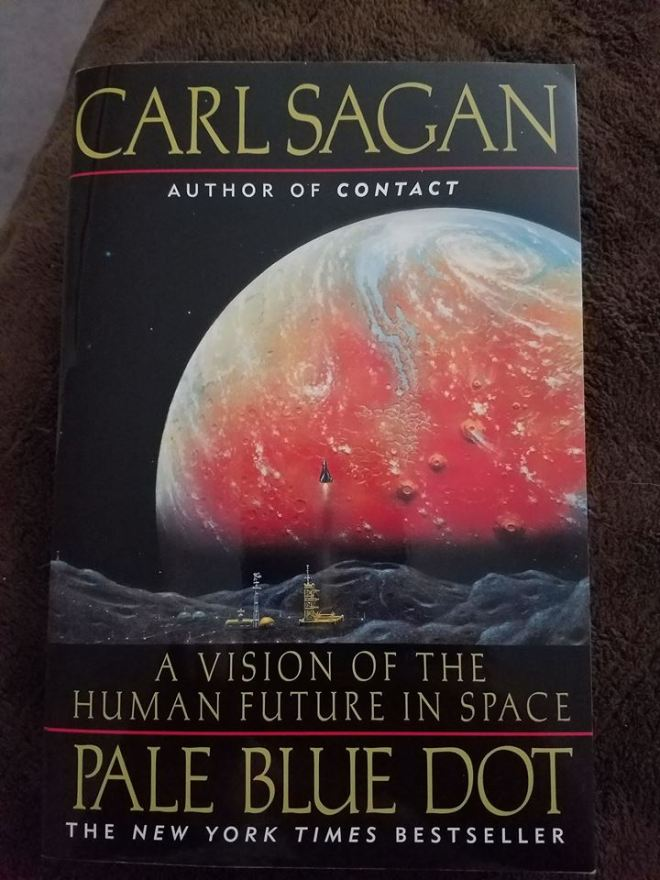 Image may contain: text that says 'CARL SAGAN AUTHOR OF CONTACT A VISION OF THE HUMAN FUTURE IN SPACE PALE BLUE DOT THE NEW YORK TIMES BESTSELLER'