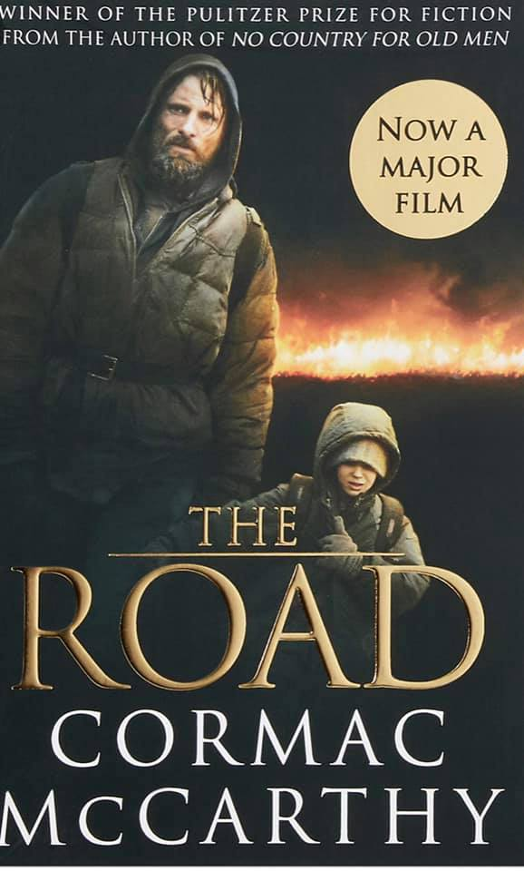 Image may contain: 2 people, text that says 'WINNER OF THE PULITZER PRIZE FOR FICTION FROM THE AUTHOR OF NO COUNTRY FOR OLD MEN NOW A MAJOR FILM THE ROAD CORMAC MCCARTHY'