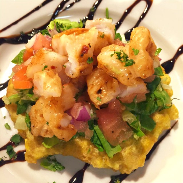 Tostones con Camarones: green plantain topped with bruschetta & mojo shrimp