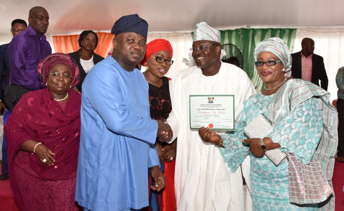 "Lagos State Governor, Mr. Akinwunmi Ambode (2nd left), presenting a Certificate of Merit to Hon. Abayomi Lapete and his Wife, Oluwatoyin during the 2016 International Day of Families themed ""Families, Healthy Lives and Sustainable Future"", at the Lagos House, Ikeja, on Sunday, May 15, 2016. With them are Deputy Governor, Dr. (Mrs.) Oluranti Adebule (left) and Wife of Lagos State Governor, Mrs. Bolanle Ambode (middle)."