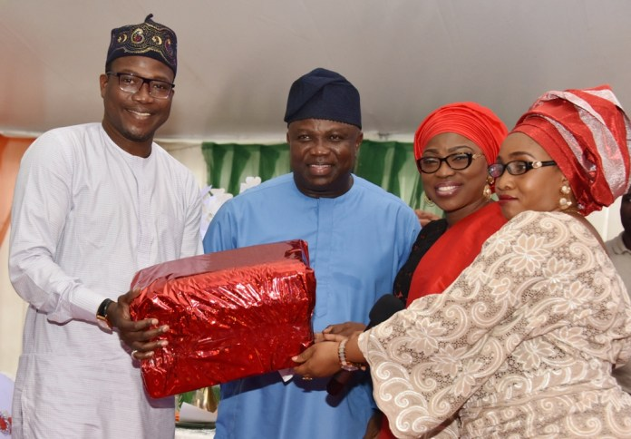 Lagos State Governor, Mr. Akinwunmi Ambode (2nd left), his Wife, Bolanle (2nd right), being presented with a gift by Commissioner for Youths & Social Development, Pharm. (Mrs.) Uzamat Akinbile-Yusuf (right) and Permanent Secretary, Ministry of Youths & Social Development, Mr. Hakeem Muri-Okunola