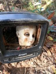 Another creepy doll's head in a TV.