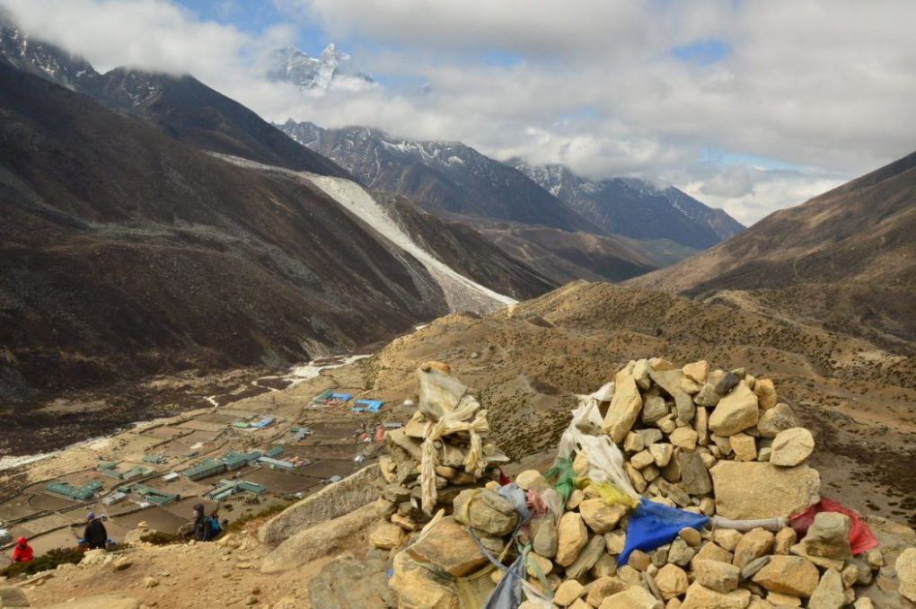 rocks with prayer flags overlooking mountains at Dingboche