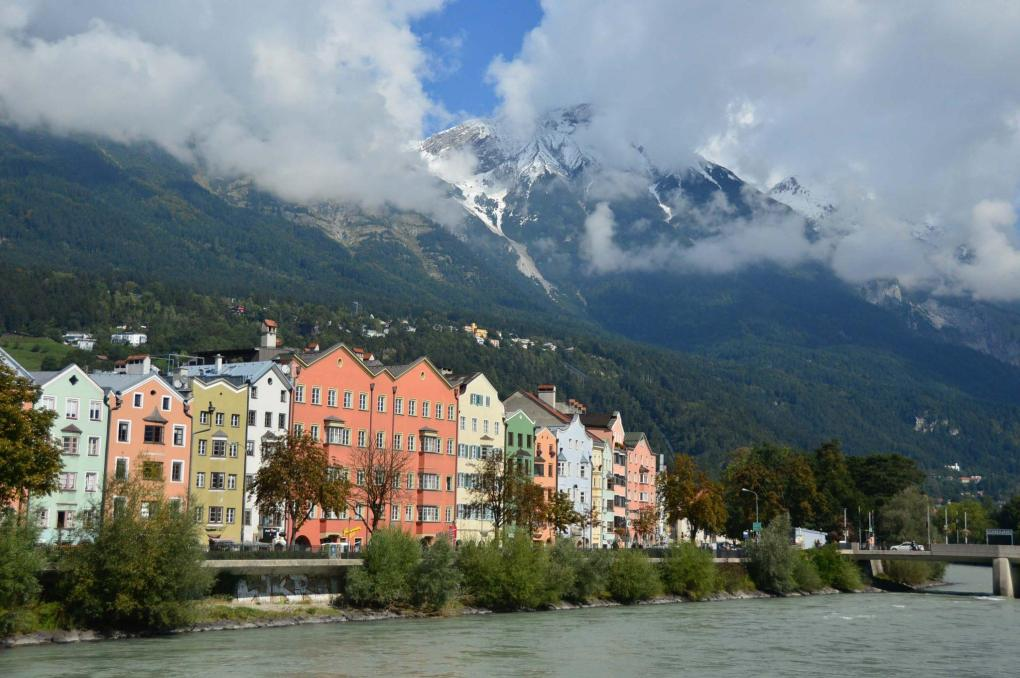 colourful houses on the water with a mountain behind innsbruck highlights