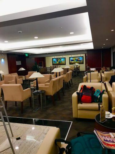 seats and lamps wide shot of business class lounge medellin airport