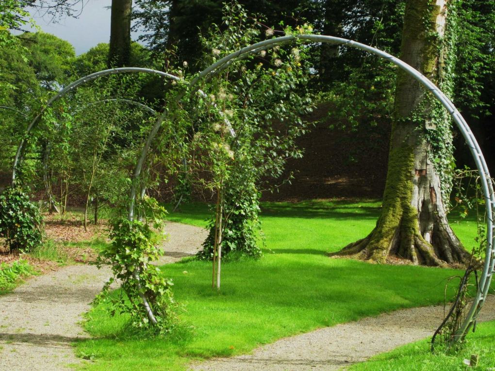 arch shaped sculptures with greenery in gardens at monart spa ireland